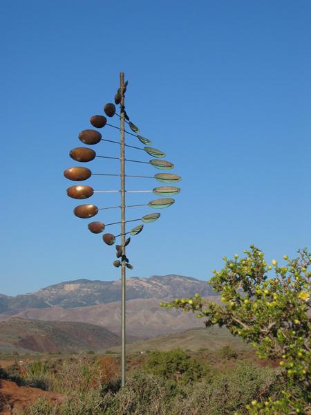 Double-Helix-Horizontal-Wind-Sculpture-Lyman-Whitaker-blue-sky