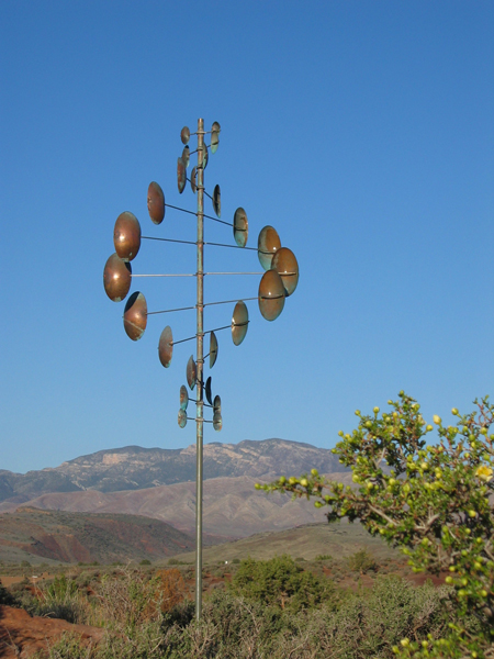 Double-Helix-Vertical-Wind-Sculpture-Lyman-Whitaker-blue-sky