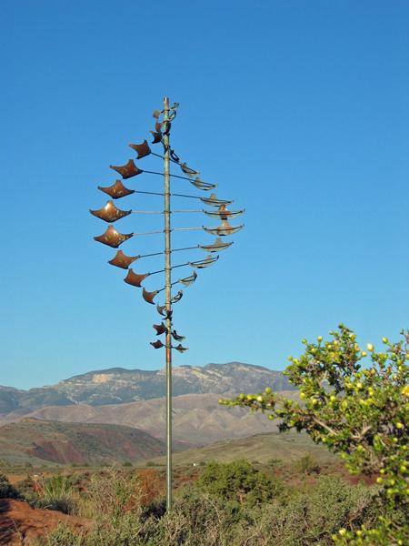 Star-Dancer-Horizontal-Wind-Sculpture-by-Lyman-Whitaker-blue-sky