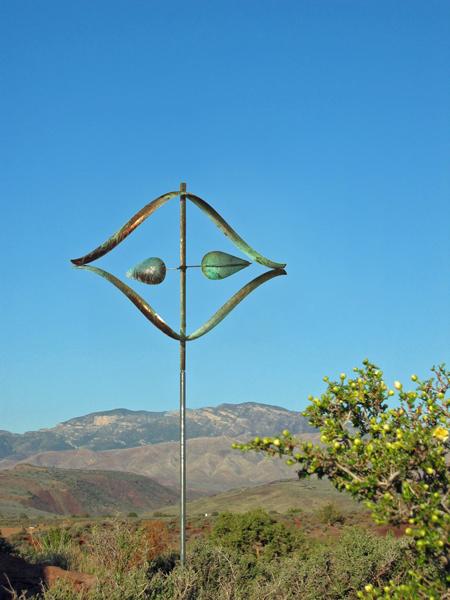 Stream-Wind-Sculpture-by-Lyman-Whitaker-blue-sky
